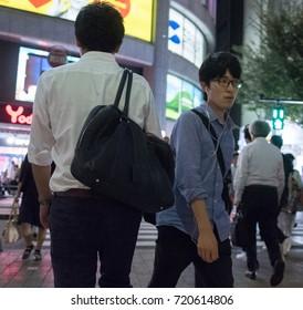 TOKYO, JAPAN - SEPTEMBER 21ST, 2017. People at the streets of Akihabara Electric Town at night.