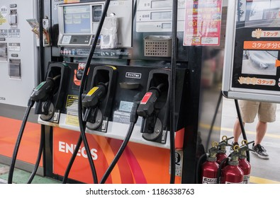 TOKYO, JAPAN - SEPTEMBER 22ND, 2018. Gas pump nozzles in a petrol gas station.