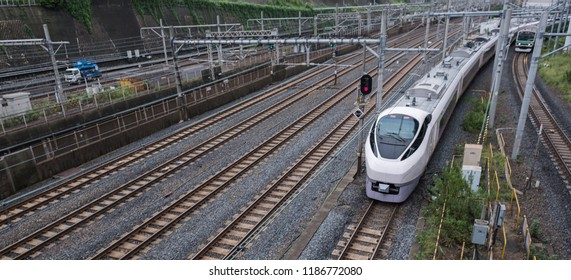 TOKYO, JAPAN - SEPTEMBER 22ND, 2018. Narita Express high speed train traveling at Nippori Station Railway track.