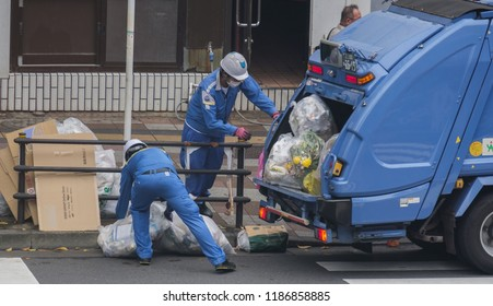 TOKYO, JAPAN - SEPTEMBER 22ND, 2018. Garbage collectors collecting rubbish in the morning at Nippori Station.