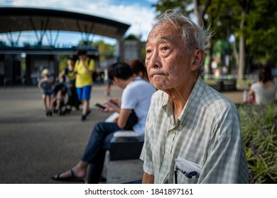 Tokyo, Japan - September 23, 2019: An old man sitting on a bench in Tokyo.