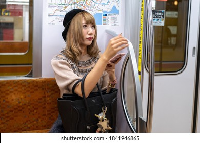 Tokyo, Japan - September 23, 2019:A young girl in the Tokyo Subway.