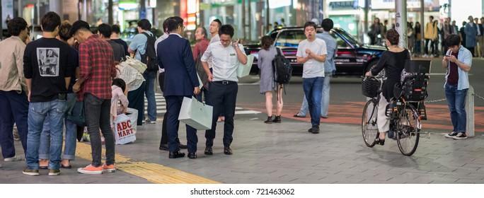 TOKYO, JAPAN -SEPTEMBER 23RD, 2017. Crowd of people at Shibuya sidewalk street at night.