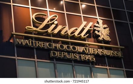 TOKYO, JAPAN -SEPTEMBER 23RD, 2017. Lindt chocolate company building at night in Shibuya.