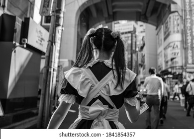 Tokyo, Japan - September 25, 2019: A maid cafe employee on the streets of Tokyo.