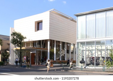TOKYO, JAPAN - September 28, 2018: View of a street in Tokyo's Daikanyama area with modern clothes stores.