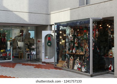 TOKYO, JAPAN - September 28, 2018: Shops in the Fumihiko Maki-designed Daikanyama Terrace including one specializing in Christmas products.