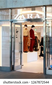 TOKYO, JAPAN - September  28, 2018: View of an entrance to a Zara clothes store in Toyko's Roppongi Hills with fashionably clad mannequins inside.