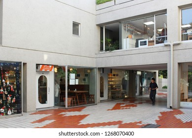 TOKYO, JAPAN - September 28, 2018: Section of a square in the distinctive Fumihiko Maki-designed Daikanyama Terrace complex. It includes a cafe and a store specializing in Christmas products.