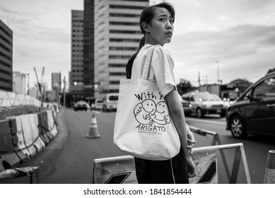 Tokyo, Japan - September 28, 2019: A young girl on the streets on Tokyo.