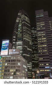 Tokyo, Japan - September 29, 2016: Night photo of the cocoon building, the Tokyo Mode Gakuen, adjacent to L-building. Plenty of lights and a few large neon signs.