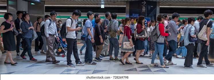 TOKYO, JAPAN - SEPTEMBER 29TH, 2017. Commuters at the Japan Railway train station.