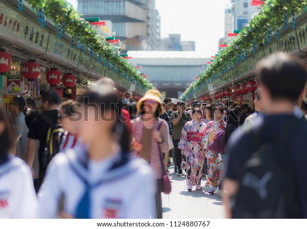 Taitō, Tokyo / Japan - September 29th 2017: Japanese and tourists visit Nakamise-dori shopping street at Senso-ji Temple in Tokyo, the oldest Buddhist temple of Tokyo located in Asakusa.