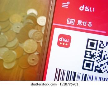 Tokyo, Japan, September 30, 2019 : the mobile payment application d-barai by Docomo partly taken with Japanese coin money. The concept of cashless payment that Japan government is trying to promote