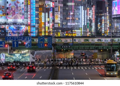 TOKYO, JAPAN - SEPTEMBER 6TH, 2018.  Night scene of a commuter train passing on a road bridge at Kabukicho district in Shinjuku.