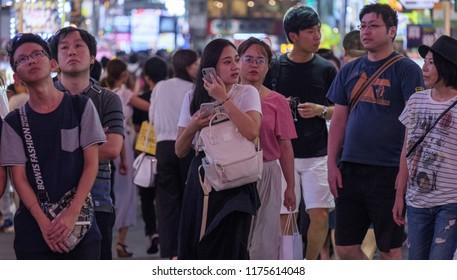 TOKYO, JAPAN - SEPTEMBER 6TH, 2018. Pedestrian crowd waiting to cross the street of Kabukicho district in Shinjuku.