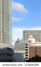 TOKYO, JAPAN - September 8, 2018: View of Tokyo skyline's including part of Tokyo Midtown & the landmark 248-m Midtown Tower (left) & the offices of talent agency Johnny and Associates.