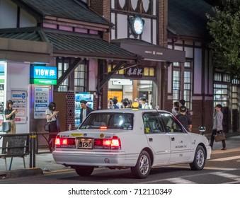 TOKYO, JAPAN - SEPTEMBER 8TH, 2017. Public taxi in Omotesando street at night.