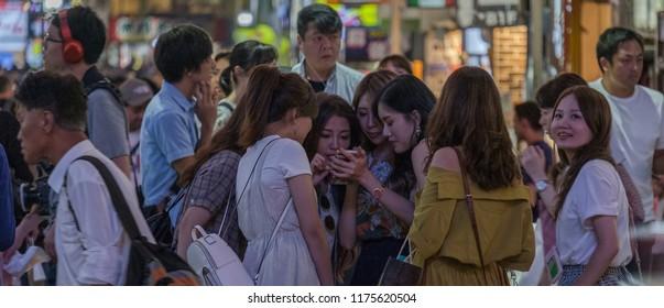 TOKYO, JAPAN - SEPTEMBER 9TH, 2018.  Young Japanese girls at the street of Kabukicho district in Shinjuku.