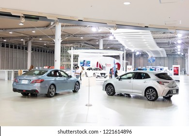 Tokyo, Japan - Septmeber 6, 2018: Metallic silver Toyota Crown and Corolla Sport hybrid cars at Toyota Heartful Plaza, produced by Japanese automaker Toyota.