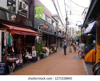 Tokyo, Japan-April 19, 2012: People walking along old shopping street, Yanaka Ginza, Tokyo