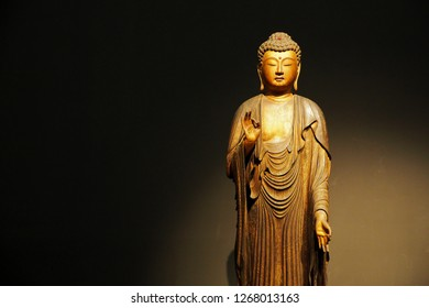 Tokyo, Japan-December 6,2018: A beautiful ancient wooden sculpture depicting image of Buddha