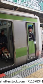 Tokyo Japanese, 10 April, 2017: The staff at the train station ensured the passengers were in safe condition before the door train closed
