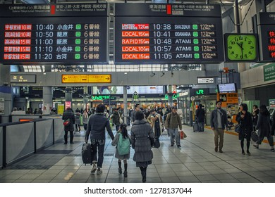 Tokyo, Japan-January 3, 2018: Railway station Shinagawa. A view of the passengers' hall. The commuters walk to their terminals. There is a timetable in Japanese and English above the passageway.