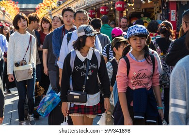 TOKYO, JAPAN-October 20: Crowded people heading to the Buddhist Temple Sensoji on October 20, 2016 in Tokyo, Japan. The Sensoji temple in Asakusa area is the oldest temple in Tokyo.
