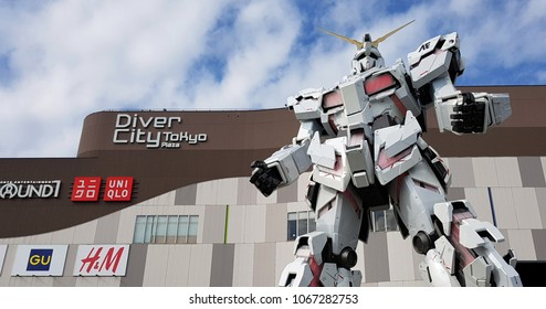 "Tokyo, JP - JANUARY 30, 2018: The real-size of the white robot named ""Mobile Suit Gundam Unicorn"" that standing in front of the Diver City Tokyo Plaza building, Odaiba area."
