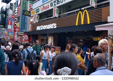 Tokyo, JP - SEPTEMBER 30, 2018: Crowd of people walking at the Takeshita Fashion Walking Street, the most famous place for teenagers and J-Pop culture fans in Harajuku District, Tokyo.