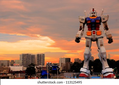 TOKYO - JULY 10: A 59-foot tall life-size replica of Gundam displayed at Odaiba island on July 10 2009 in Tokyo. It is displayed here for 2 months to celebrate 30 years anniversary of Gundam.