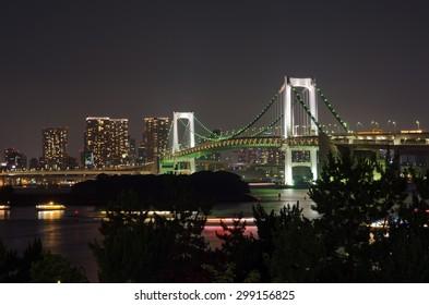TOKYO - JULY 11 :Nightscape on Tokyo city and rainbow bridge on July 11, 2015, Odaiba, Tokyo.