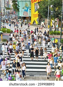 TOKYO - JULY 26, 2014: Pedestrian crossing in the corner of La Foret Harajuku fashion building and Tokyu Plaza shopping complex in Omotesando and Harajuku area, downtown Tokyo.