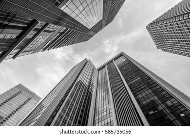 Tokyo, July 26, 2015. Low angle view of skyscraper buildings scenery. Marunouchi district located in Chiyoda Ward.