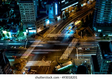 Tokyo - June 2016: Aerial view of junction with glowing light trails from traffic.