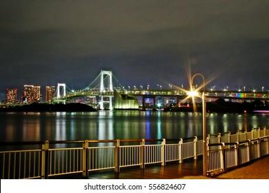 Tokyo, Kanto region, Japan - September 12, 2009 - The Rainbow Bridge, a suspension bridge crossing northern Tokyo Bay between Shibaura Pier and the Odaiba waterfront development in Minato