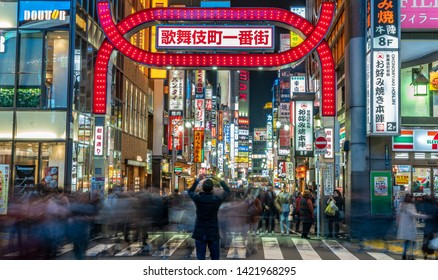 Tokyo - March 15, 2019 : Panoramic view of Unidentified person making pictures and Motion blured people walking at Kabukicho entertainment and Red Light district in Shinjuku Ward, Tokyo