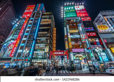 Tokyo - March 15, 2019 : Wide angle view of Motion blured people walking through the entrance of Kabukicho entertainment and Red Light district in Shinjuku Ward, Tokyo