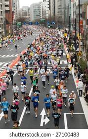 TOKYO – MARCH 22 : Top view of runners at Tokyo Marathon held on March 22, 2009 in Tokyo, Japan. Kenyan Salim Kipsang won the Tokyo Marathon in 2 hours, 10 minutes, 27 seconds.