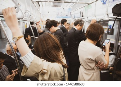TOKYO- MAY 10, 2019 : Passenger using smartphone in Tokyo jr train line.East Japan Railway Company is a major passenger railway company in Japan and one of the seven Japan Railways Group companies.