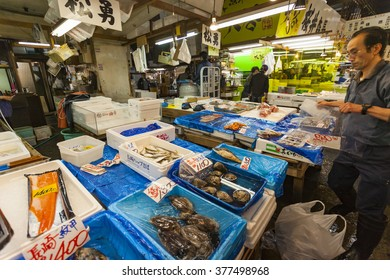 TOKYO - MAY 11: Shoppers visit Tsukiji Fish Market on May 11, 2014 in Tokyo. It is the biggest wholesale fish and seafood market in the world.