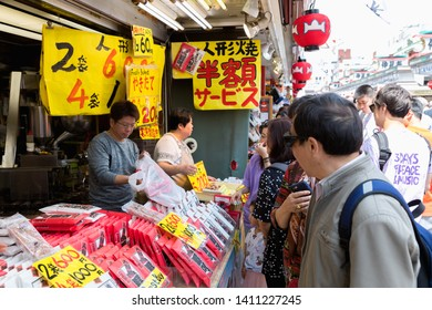 TOKYO - MAY 12, 2019: Nakamise shopping street in Asakusa, Tokyo. The busy arcade connects Senso-ji Temple to it's outer gate Kaminarimon, which can just be seen in the distance.