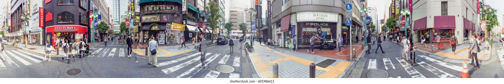 TOKYO - MAY 19, 2016: Tourists in Shinjuku. Tokyo attracts 5 million foreign visitors each year.