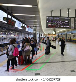 TOKYO - MAY 4: Travelers board Tohoku Shinkansen E4 series train on May 4, 2012 at Tokyo Station. There are plans to increase speed of Tohoku Shinkansen to 320km/h.