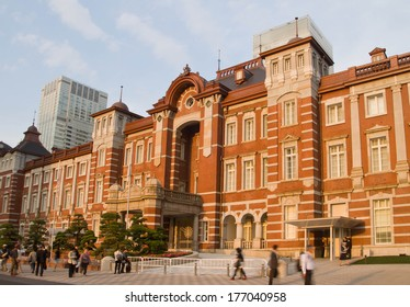 TOKYO - MAY 8: Tokyo Station is lighted up and surrounded by business buildings on May 8,2013 in Tokyo, Japan.The station is a railway station which is the busiest station in Japan