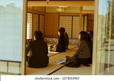 TOKYO - NOVEMBER 16, 2017: People attending a traditional Japanese tea ceremony in Nakajima Tea House. The tea house is located in the middle of a pond in Hamarikyu Gardens.