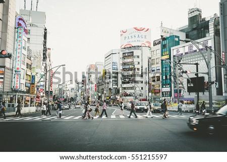 573c32531 TOKYO - NOVEMBER 17: Crosswalk on the Shinjuku Street in Tokyo, Japan on  November