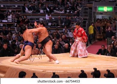 TOKYO - NOVEMBER 18: Two sumo wrestlers in a tight grip in the Fukuoka Tournament on November 18, 2010 in Fukuoka, Japan.