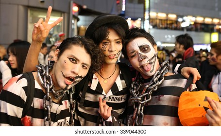 TOKYO - OCTOBER 31 2015 : Shibuya crossing area is crowded with people wearing Halloween costumes and makeup, on October 31, 2015 in Tokyo.